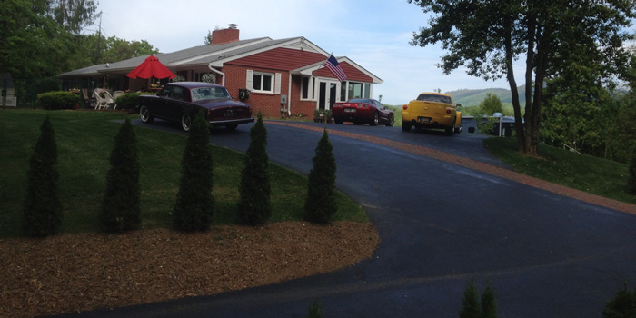 tollies, landscape, sylva, fence, lawn, fencing, landscaping, landscape installation, tree, plant, mulch, mulching, gardening, garden, sod, sod installation,